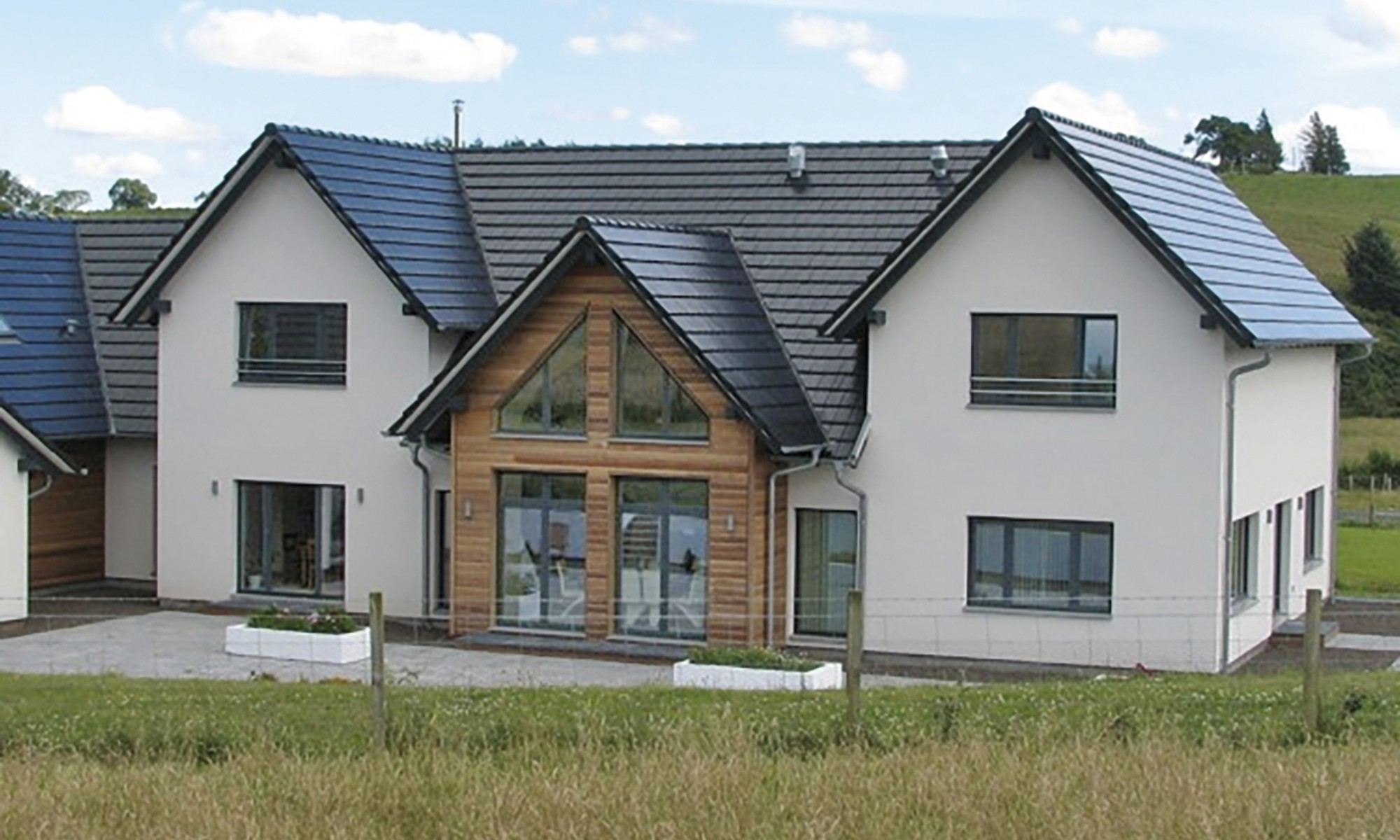 Remote prefabricated property with a built-in pool, situated in rural Scotland
